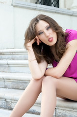 Pretty woman puts out tongue.