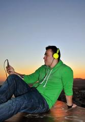 MUSIC MAN LISTENING THROUGH HEADPHONES