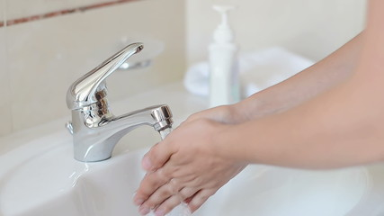 Washing and Drying Hands at Sink Faucet
