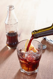 Pouring wine into kalimotxo mixture glass