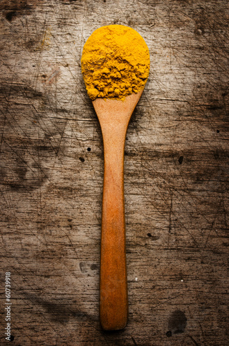 Bright spice on an old wooden board