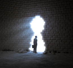 Businessman standing in a wall opening