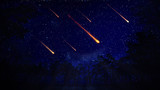Night sky with a meteor shower