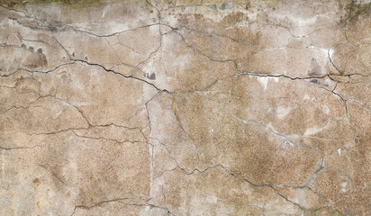 Background texture of old yellow wall with stucco and cracks