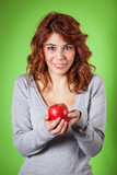 Teenage Girl Holding a Red Apple on Green Background