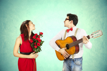 Man approaching woman playing a love song, serenade