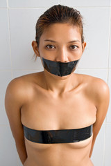 Young woman wrapped in adhesive tape