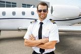 Fototapety Confident Pilot In Front Of Private Jet