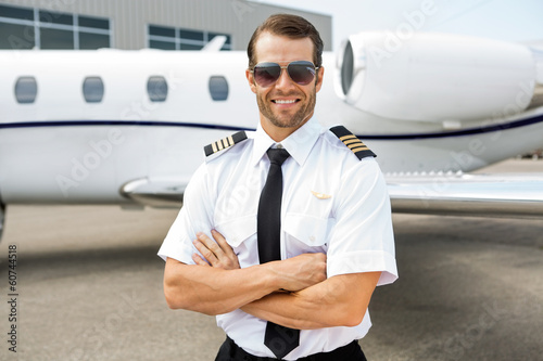 Confident Pilot In Front Of Private Jet - 60744518