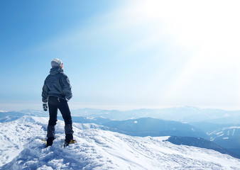 Climber on the mountain top. Active life concept