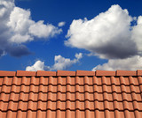 Roof tiles and cloudy sky