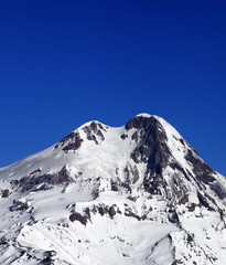 Top of Mount Kazbek at sun winter day