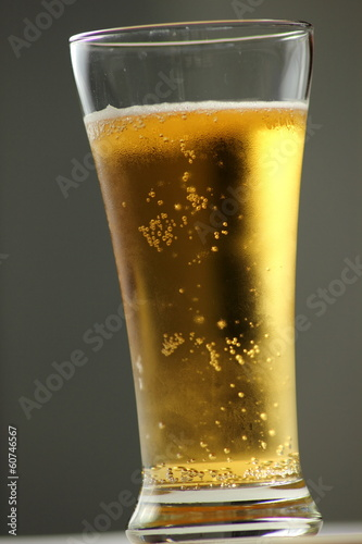 Close up of beer glass with bubbles