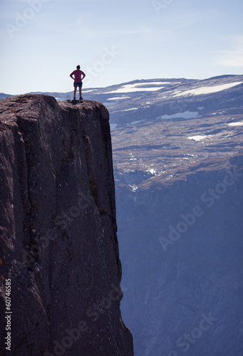 girl standing on rock in norway