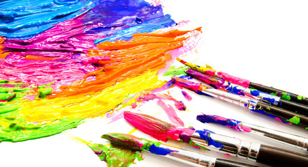 Paints and brushes isolated on a white
