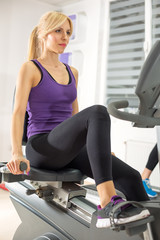 Woman exercising at the gym on a machine