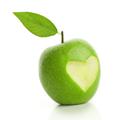 Green apple with cut heart