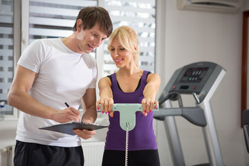 Personal trainer working with his client