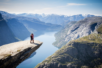 couple on trolltunga in norway