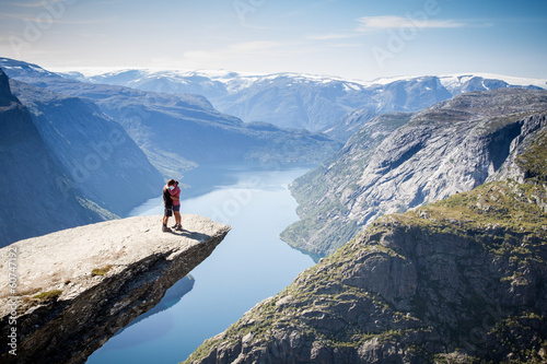 Poster couple on trolltunga in norway