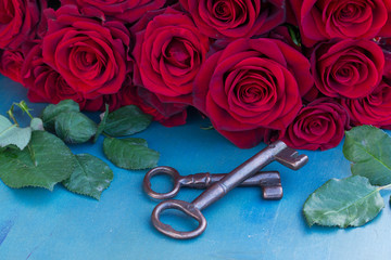 Keys with crimson roses