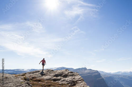 girl walking on rock