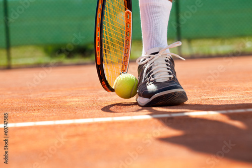 Leg with ball and tennis racket