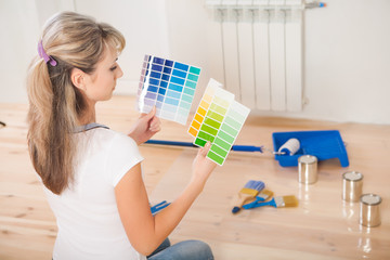 female painter holding and see in color palette