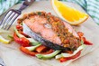 Steak red fish salmon on vegetables, zucchini and paprika