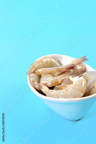 raw prawns in a white bowl