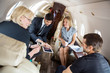Business People Discussing In Corporate Jet