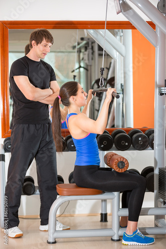 gym woman with personal trainer man