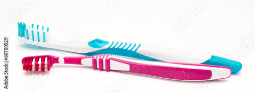 Two toothbrushes isolated on white