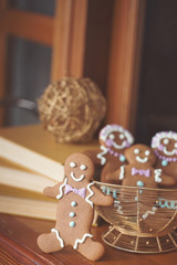 Smiling gingerbread man with additional cookies