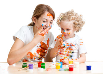 mom and kid daughter paint together