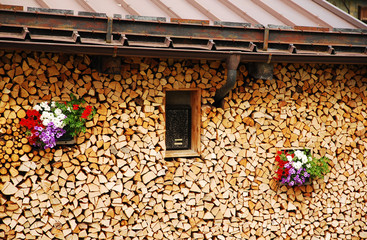 Neat Wood Stack with Flowers