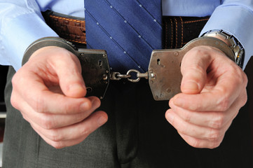 Man's hands in handcuffs before itself