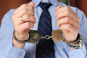Man's hands in handcuffs before itself