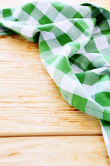 wooden table covered with green tablecloth