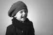 Laughing Little Boy in Cap.Handsome Child in Scurf.Smiling kid
