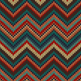 Style Seamless Knitted Pattern. Red Blue Brown Yellow Orange Col