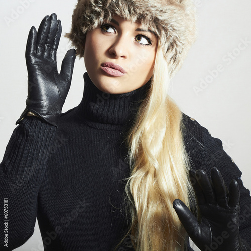 Beauty Girl in Fur Hat.Beautiful Blond Woman in Leather Gloves