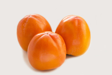 three ripe persimmon