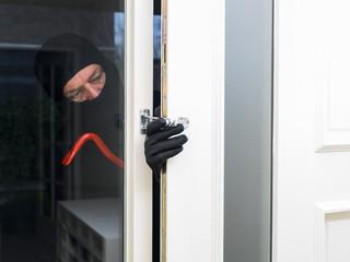 Burglar opening a door