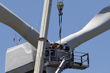 Wind turbine being repaired