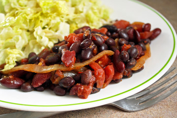 Nutritious vegetarian chili with a fresh garden salad