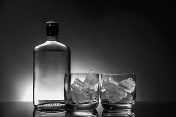 Glass and bottle of hard liquor like scotch, bourbon, whiskey or