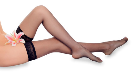 Lovely female long legs in black stockings