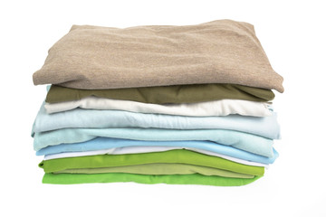 A stack of folded shirts on white background
