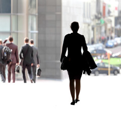 Business woman walking on the street.